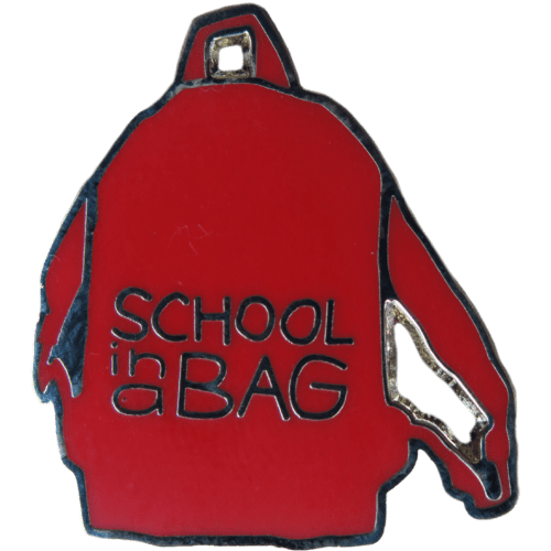 School in a Bag Pin Badge