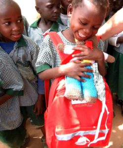 Child in Gambia with SchoolBag